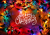 Christmas lights frame on wood background with Merry Christmas
