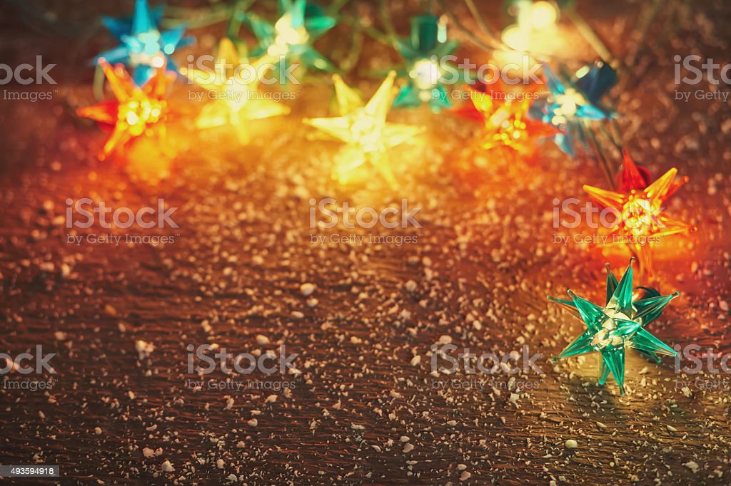 Christmas lights frame on wooden background stock photo