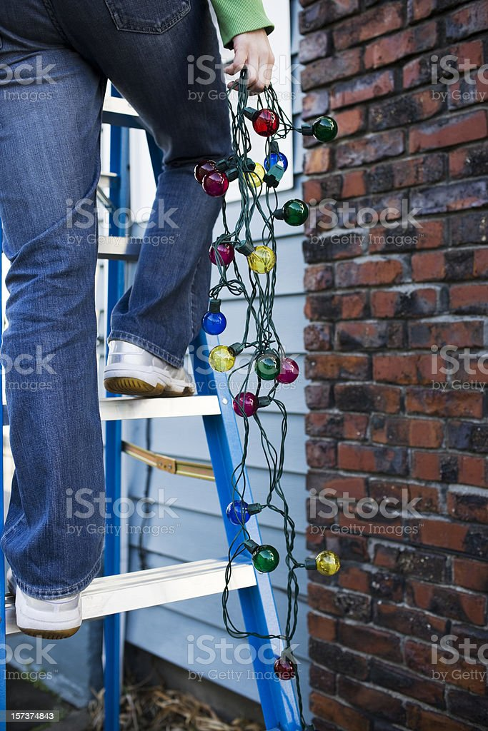 Christmas Lights Hanging from Ladder Outside Chimney, Copy Space stock photo