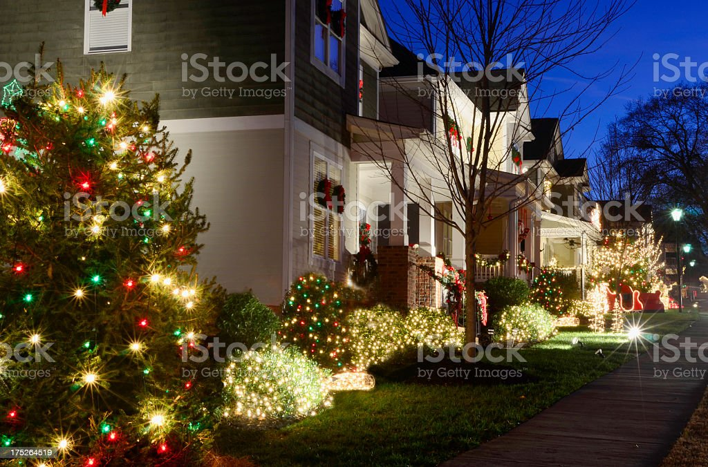 Christmas lights in front of Victorian-style homes royalty-free stock photo
