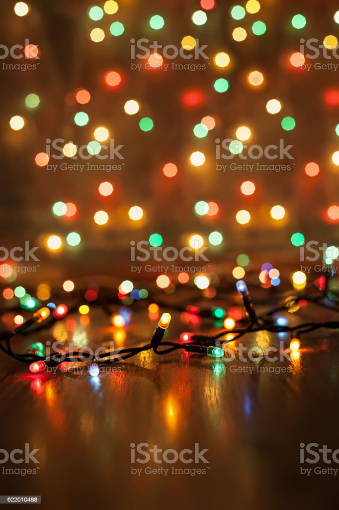 Christmas lights on a wooden background stock photo