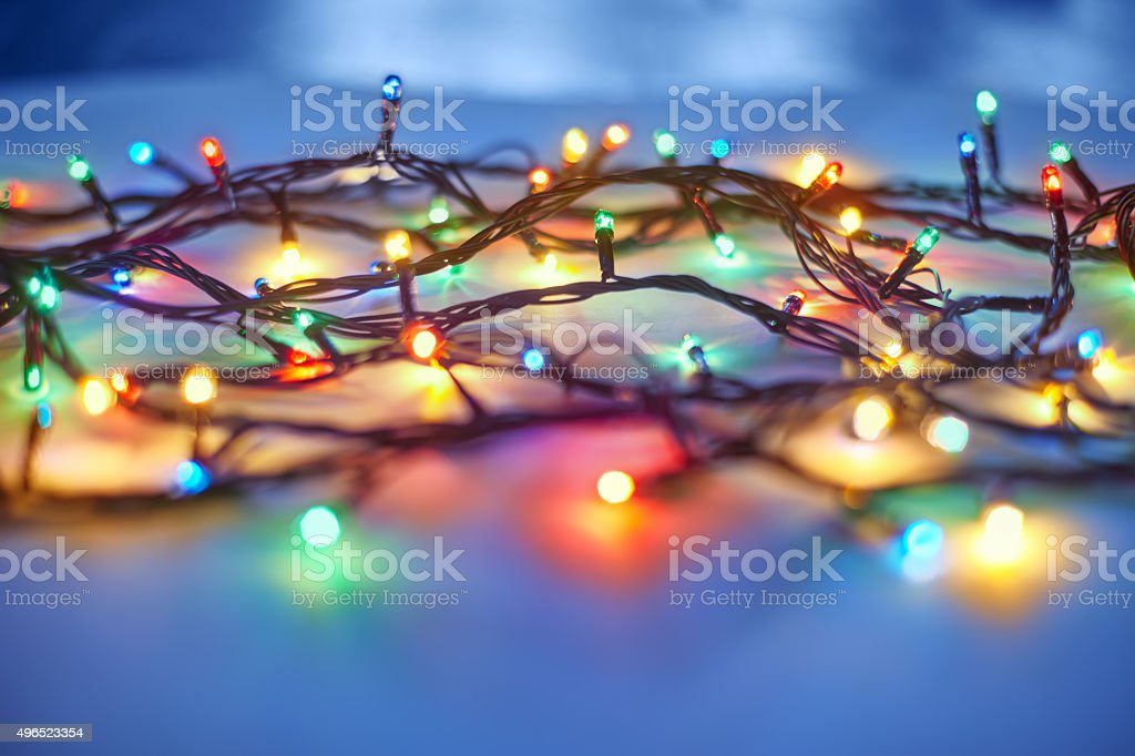 Christmas lights on dark blue background stock photo