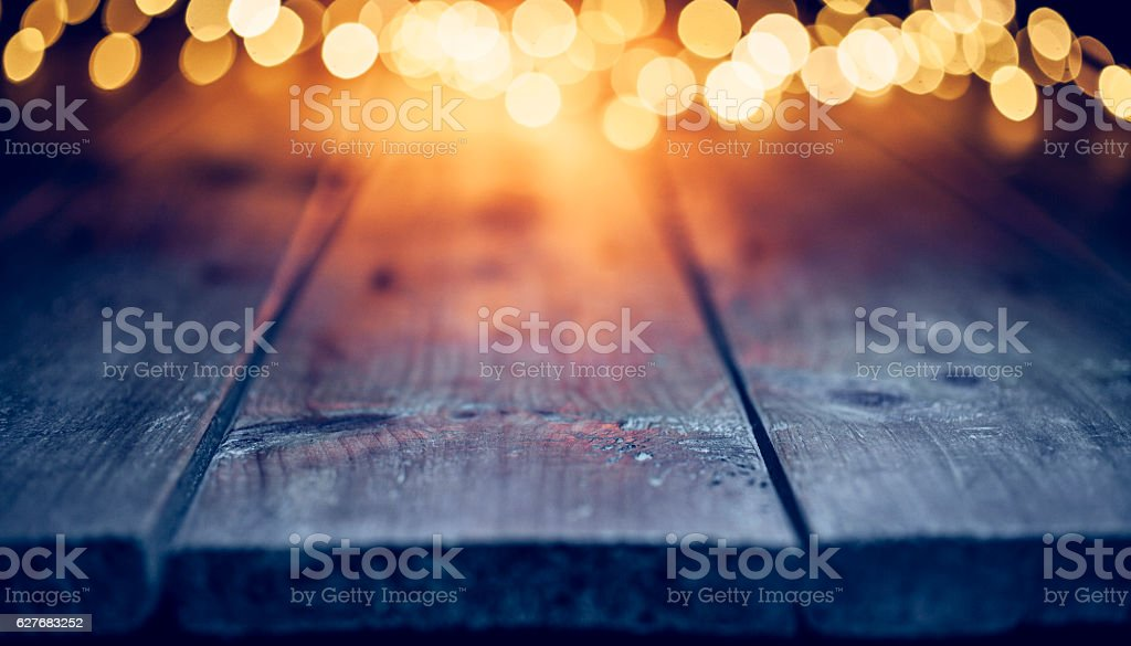 Christmas lights on empty table - Background Defocused Blue wood stock photo