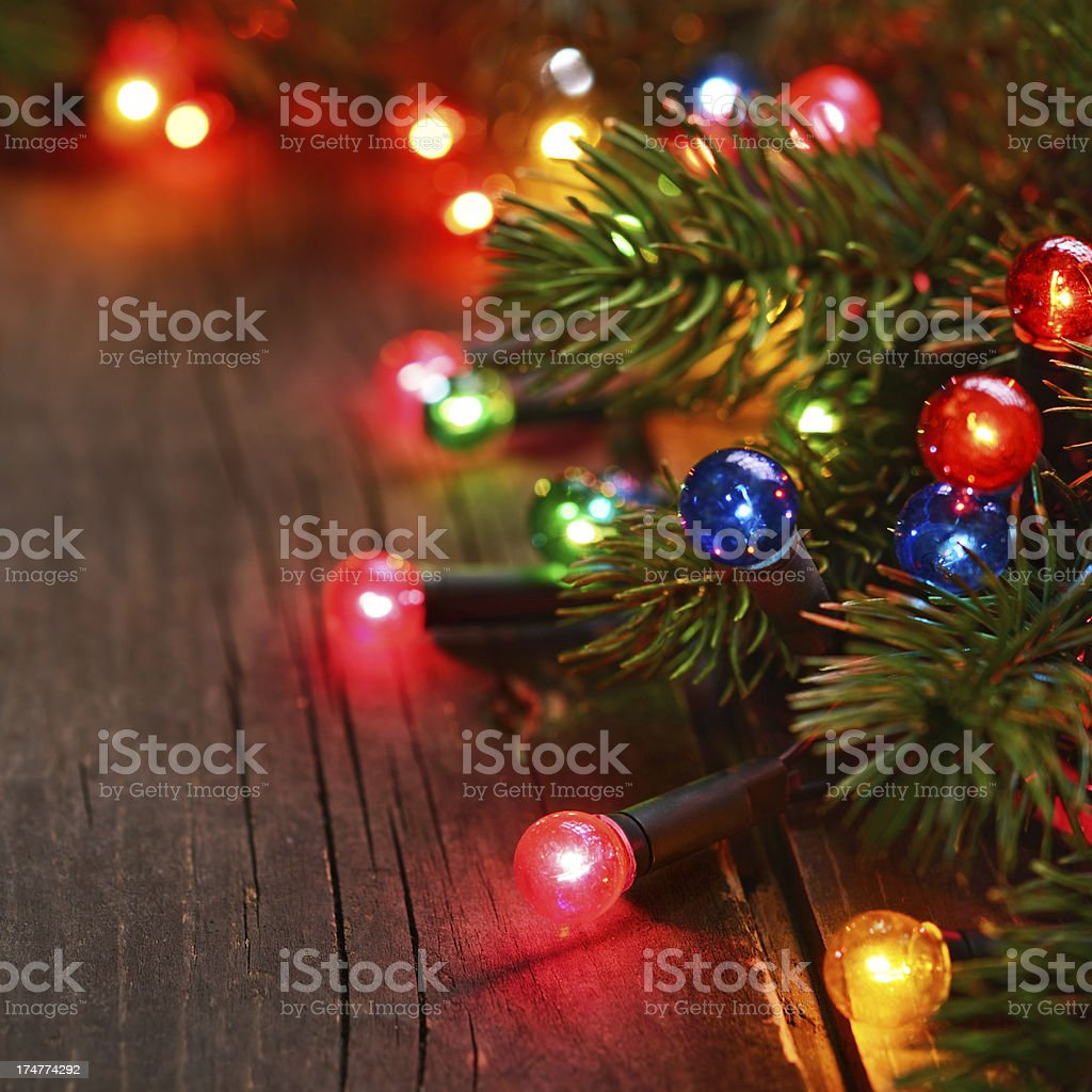 Christmas lights on rustic wood royalty-free stock photo