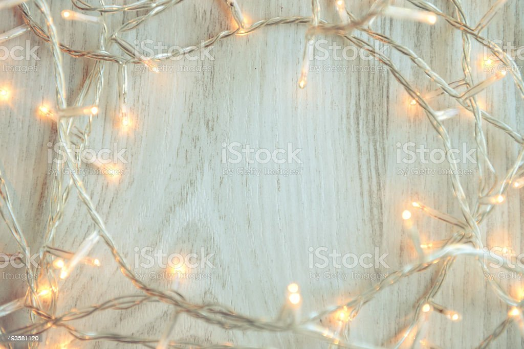 Christmas lights on white wooden background stock photo