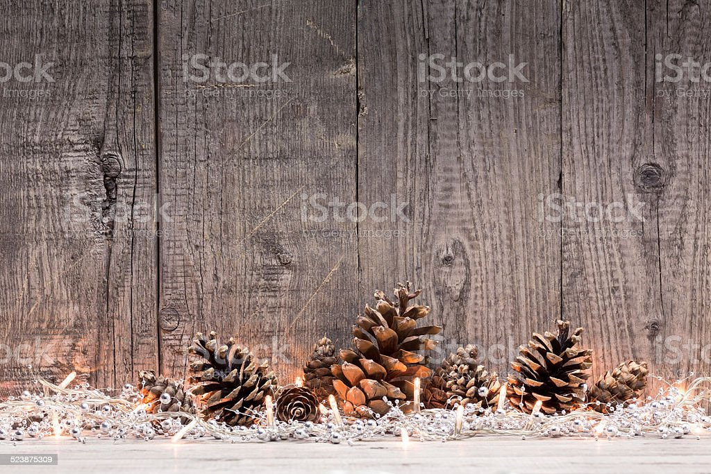 Christmas lights on wooden background stock photo