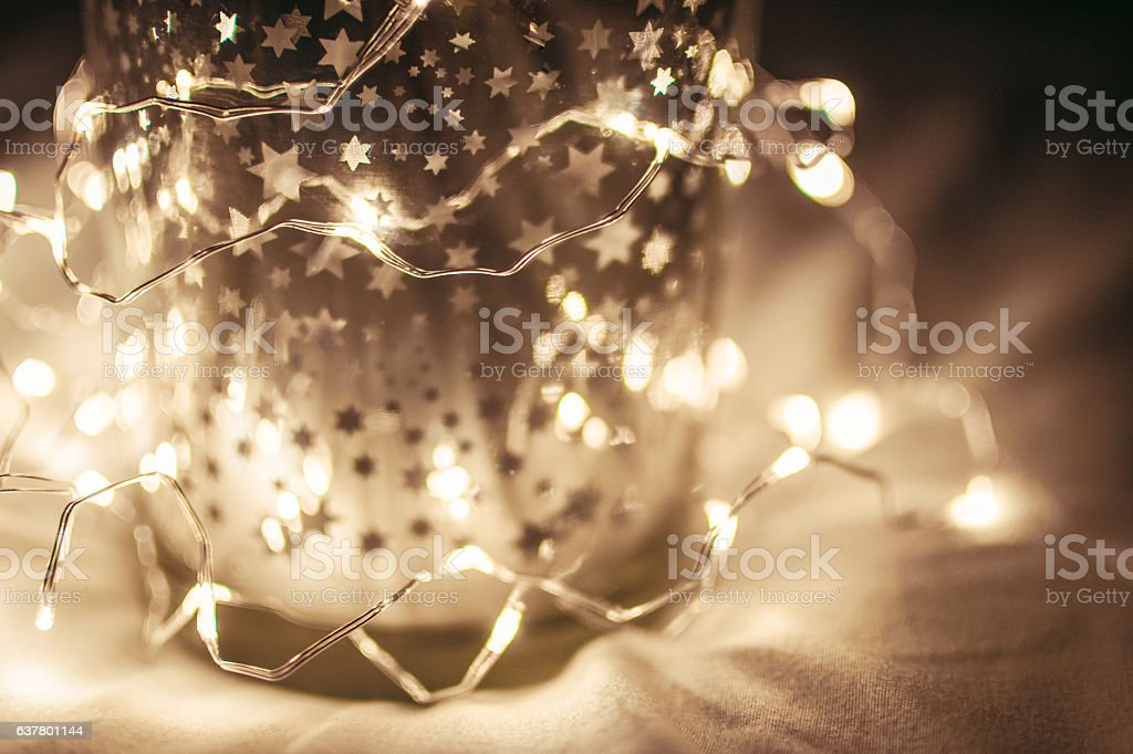 christmas lights with stars on a dark background stock photo