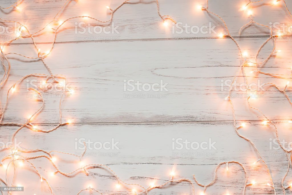 Christmas lights wooden background stock photo