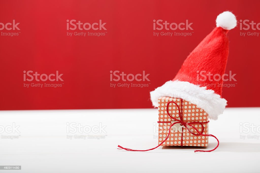 Christmas little gift box with Santa hat stock photo