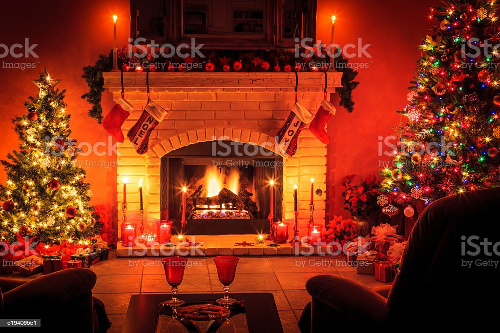 Christmas living room with fireplace and presents under tree (P) stock photo