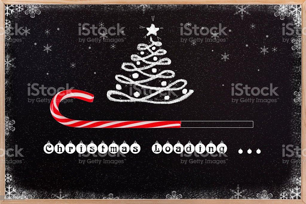 Christmas loading on blackboard. stock photo