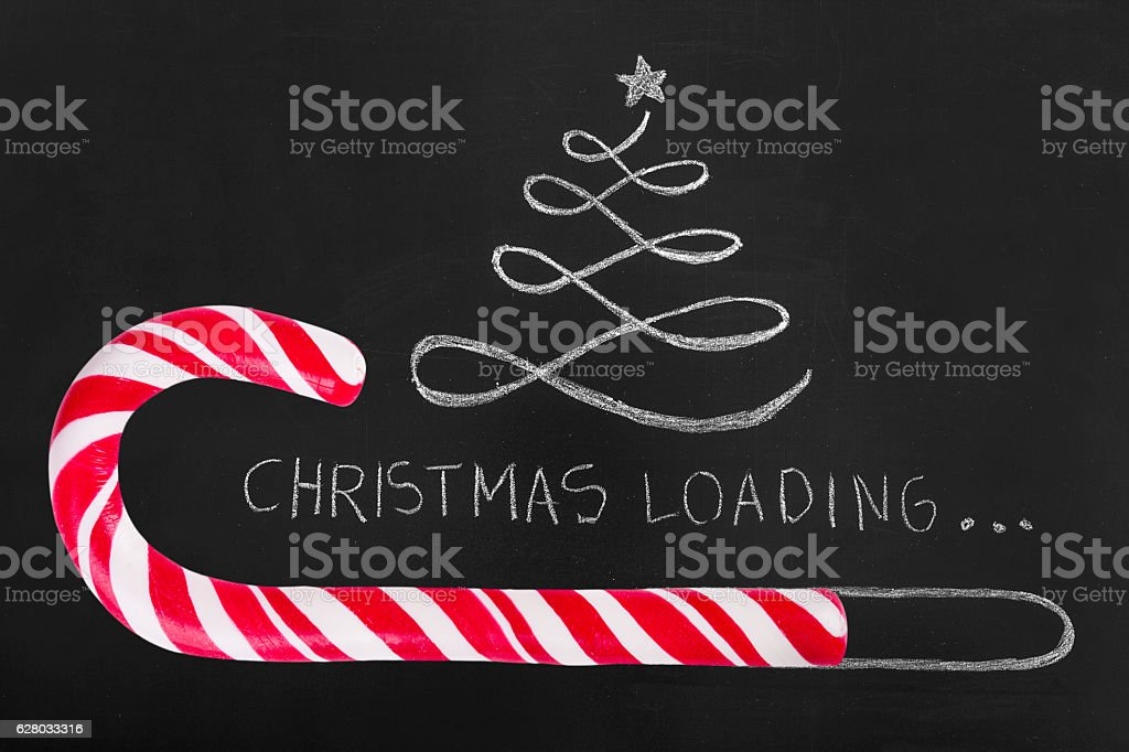 Christmas loading on blackboard. stock photo