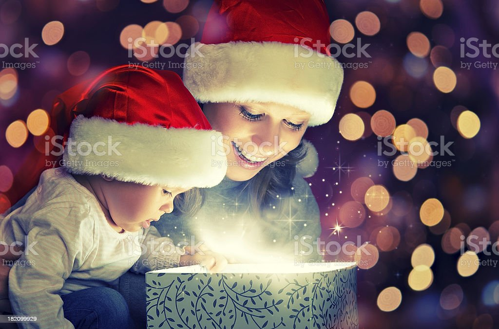 Christmas magic gift box, happy family mother and baby stock photo