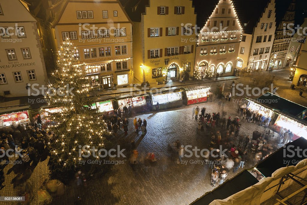 Christmas Market by night in Rothenburg ob der Tauber stock photo