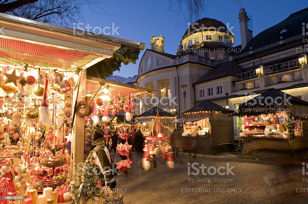 Christmas market in Merano, Kurhaus with the background royalty-free stock photo
