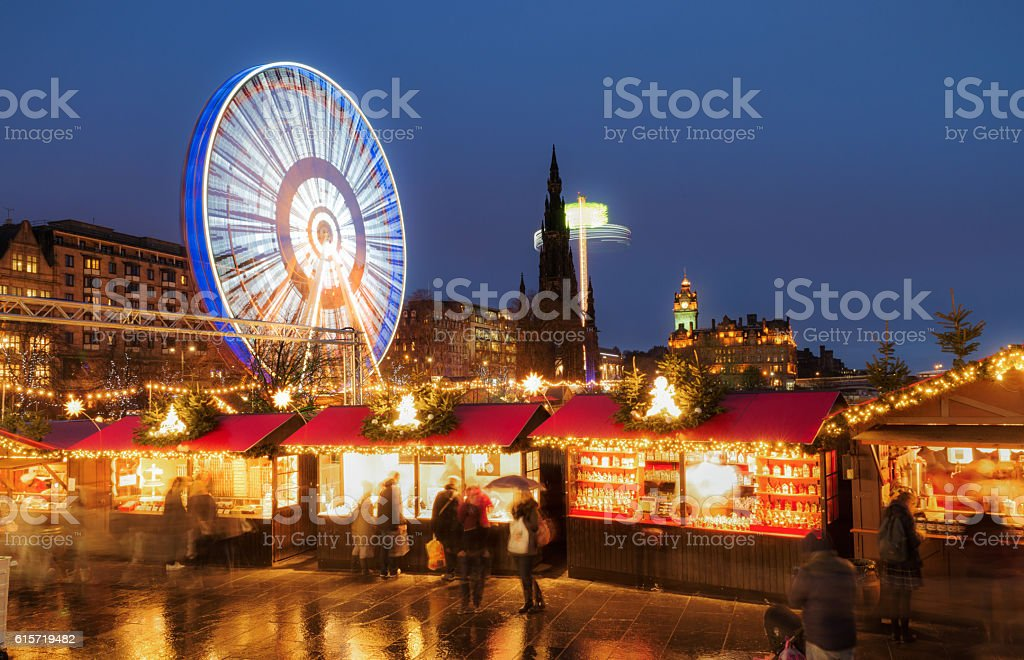 Christmas markets and amusement rides in central Edinburgh, Scotland stock photo