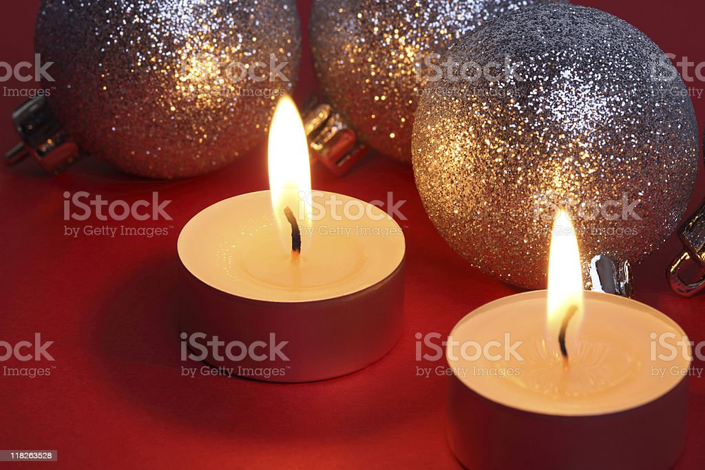 Christmas Mini Candles and Silver Bowls on Red royalty-free stock photo
