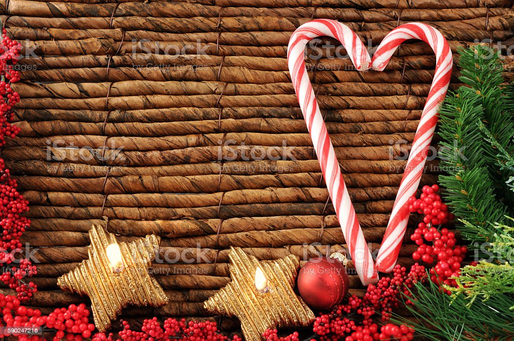 christmas mint sweets with burning candles and pine twigs. stock photo