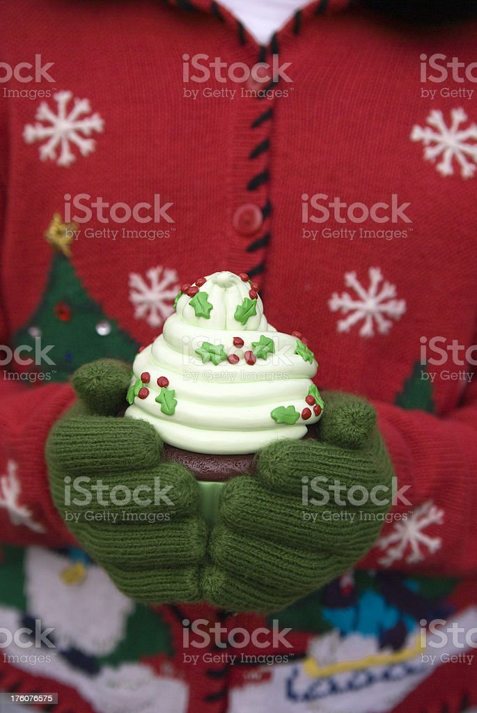 Christmas Mittens & Sweater, Cupcake Dessert, Holiday Food & Hands Background royalty-free stock photo