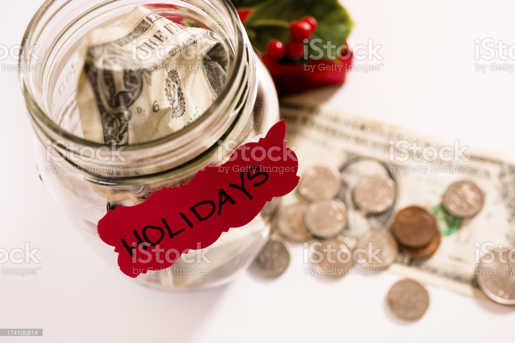 Christmas:  Money Jar with coins, dollar bills.  Saving for Holidays. royalty-free stock photo