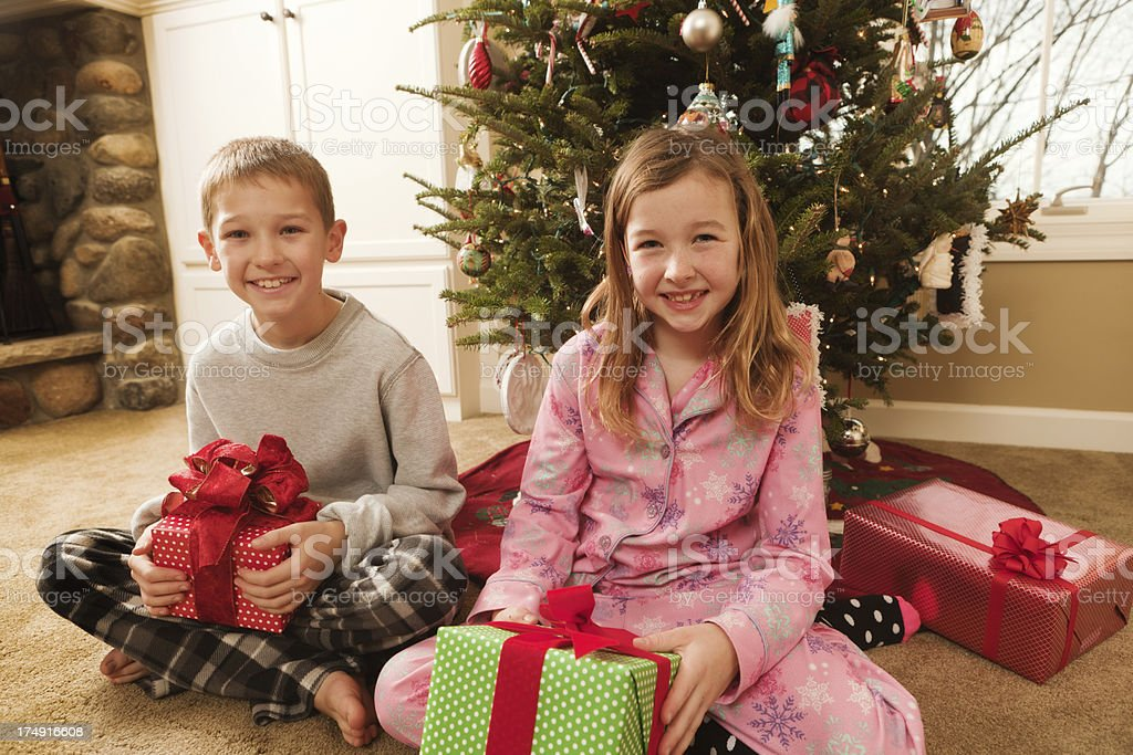 Christmas Morning Children Opening Gifts In Pajamas stock photo ...