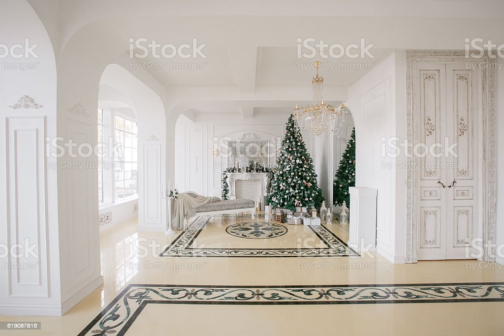 Christmas morning. classic luxury apartments with a white fireplace, decorated stock photo