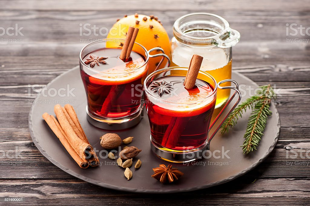 Christmas mulled wine with spices and honey stock photo