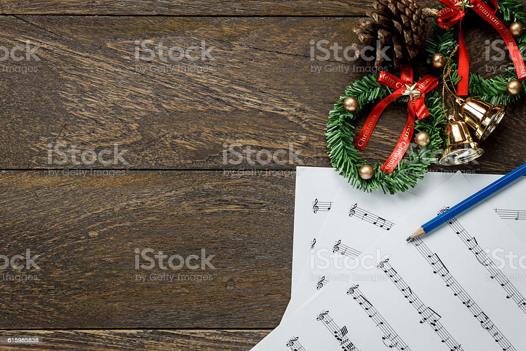 Christmas music note paper  with Christmas wreath on wooden. stock photo