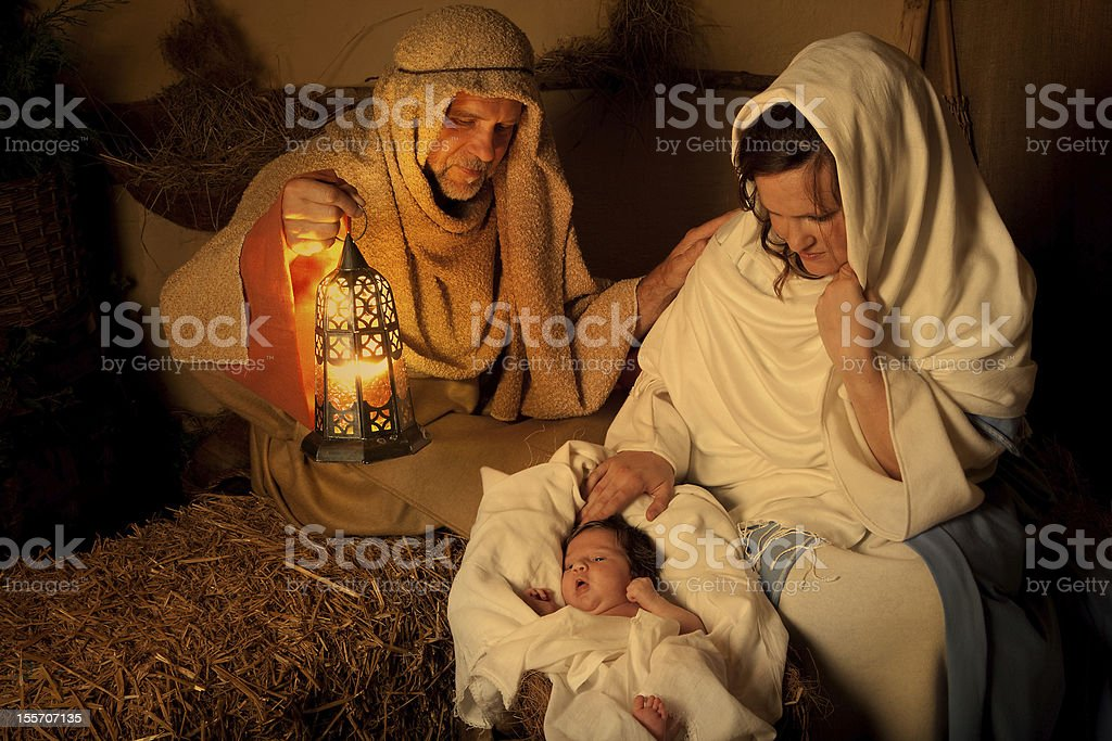 Christmas nativity scene at night stock photo
