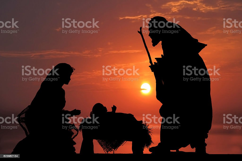 Christmas Nativity Scene; Baby Jesus, Mary and Joseph at Dusk stock photo