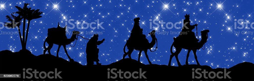 Christmas Nativity Scene, Three Wisemen Walking under Starlit Sky stock photo