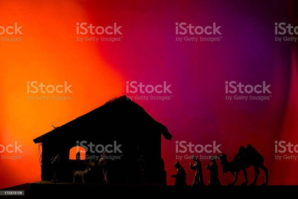 Christmas nativity scene. Wise men, Jesus, Mary, Joseph. Silhouette. Stable. stock photo