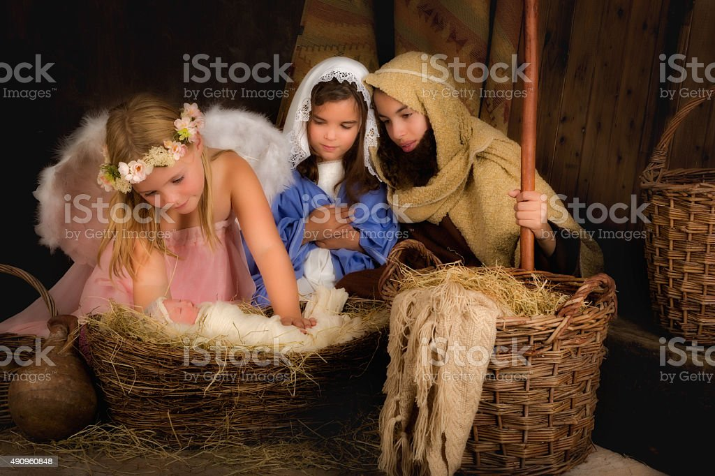 Christmas nativity scene with angel stock photo