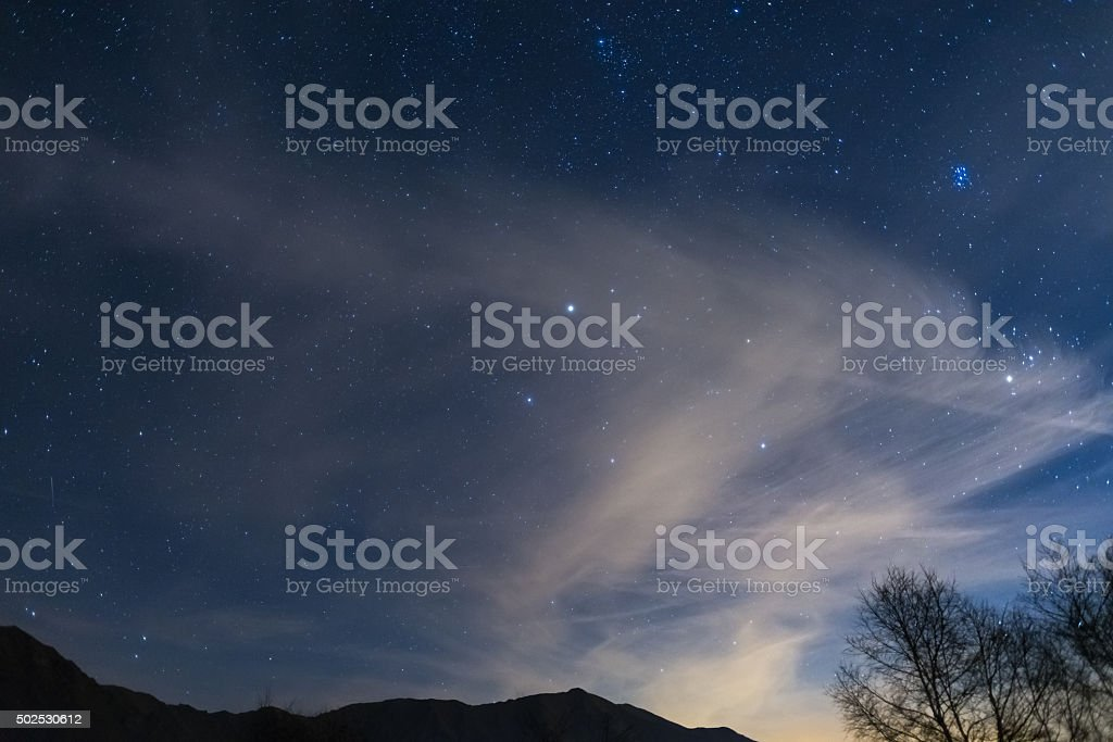Christmas night on the Alps under starry sky stock photo