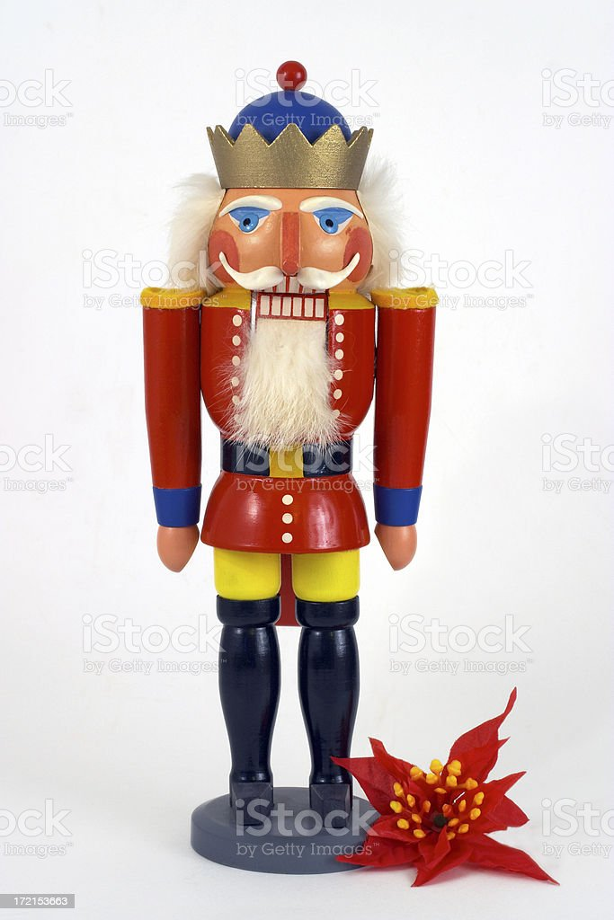 Christmas Nutcracker & Poinsettia stock photo