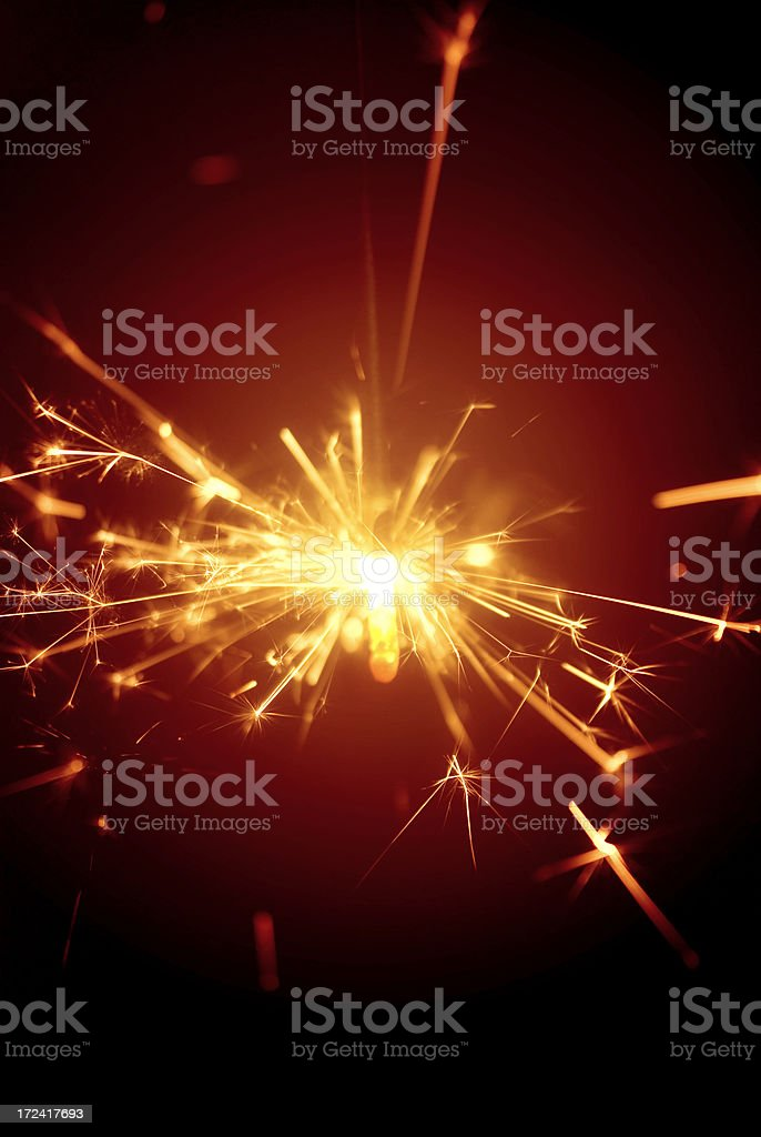 Christmas or celebration daisycutter, fire-cracker, sparkler... yellow glow on red royalty-free stock photo