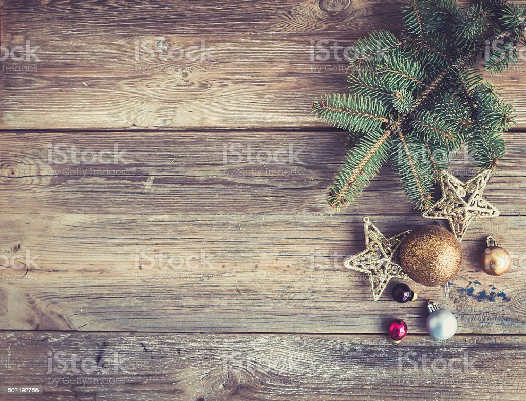 Christmas or New Year rustic wooden background with toy decorations stock photo