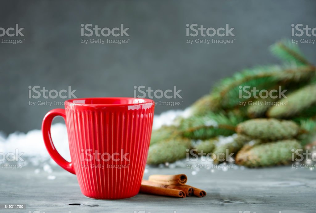 Christmas or New Year winter holidays warming spicy drink in red cup stock photo