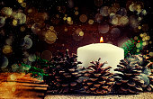 Christmas or New Year's composition with burning candle