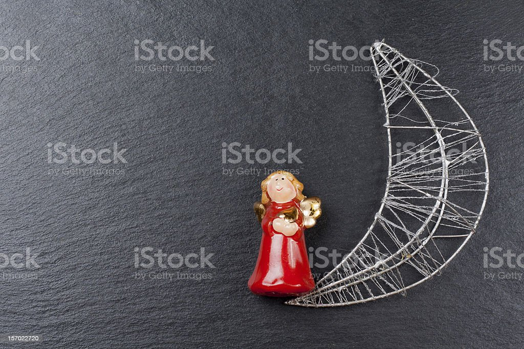 Christmas ornament: angel and silvered moon royalty-free stock photo