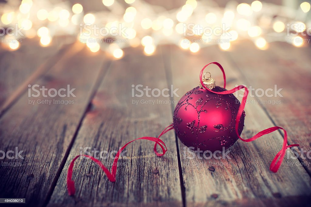 Christmas Ornament Baubles on Old Wood Background with Defocused Lights stock photo