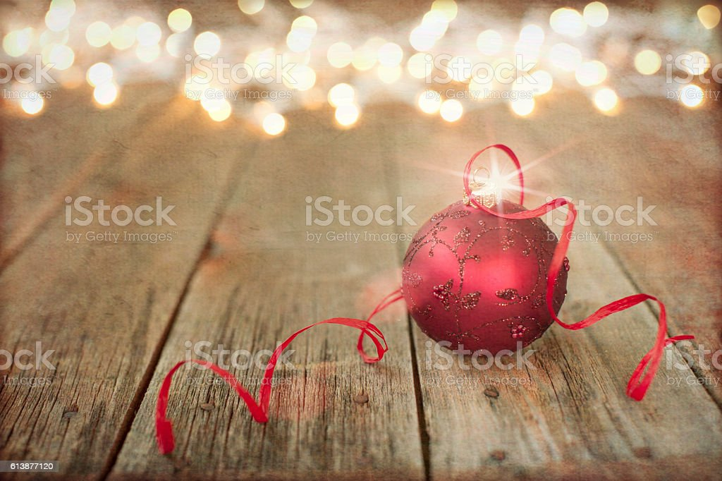 Christmas Ornament Baubles, on Old Wood Background with Defocused Lights stock photo