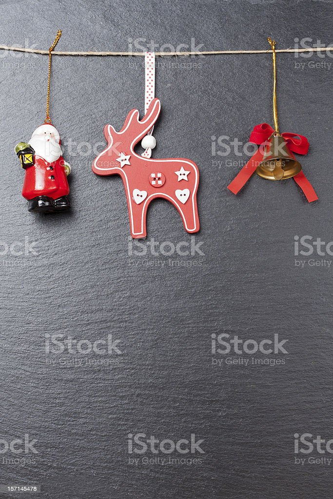 Christmas ornament: bell, red reindeer and Santa Claus royalty-free stock photo