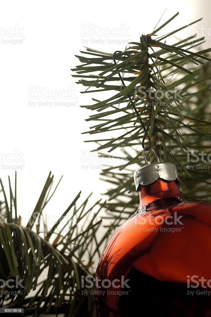 A Christmas ornament / decoration with an evergreen background. royalty-free stock photo