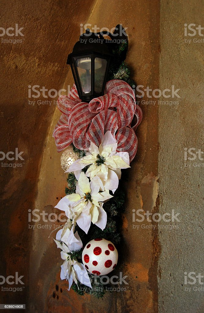 Christmas Ornament hanging on a Lantern inside of a Corridor. stock photo
