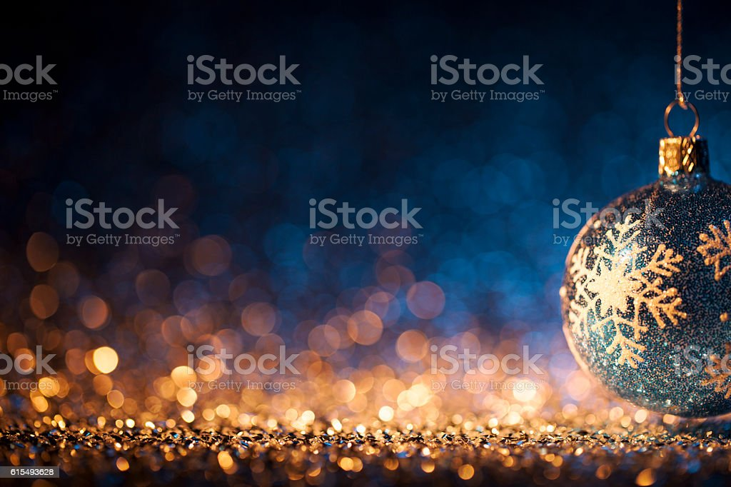 Christmas ornament on defocused lights. Decorations Bokeh Blue Gold stock photo