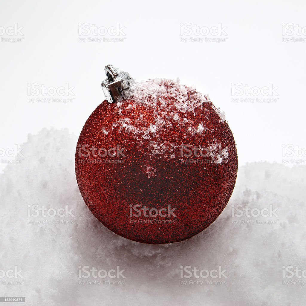 Christmas Ornament On Snow stock photo