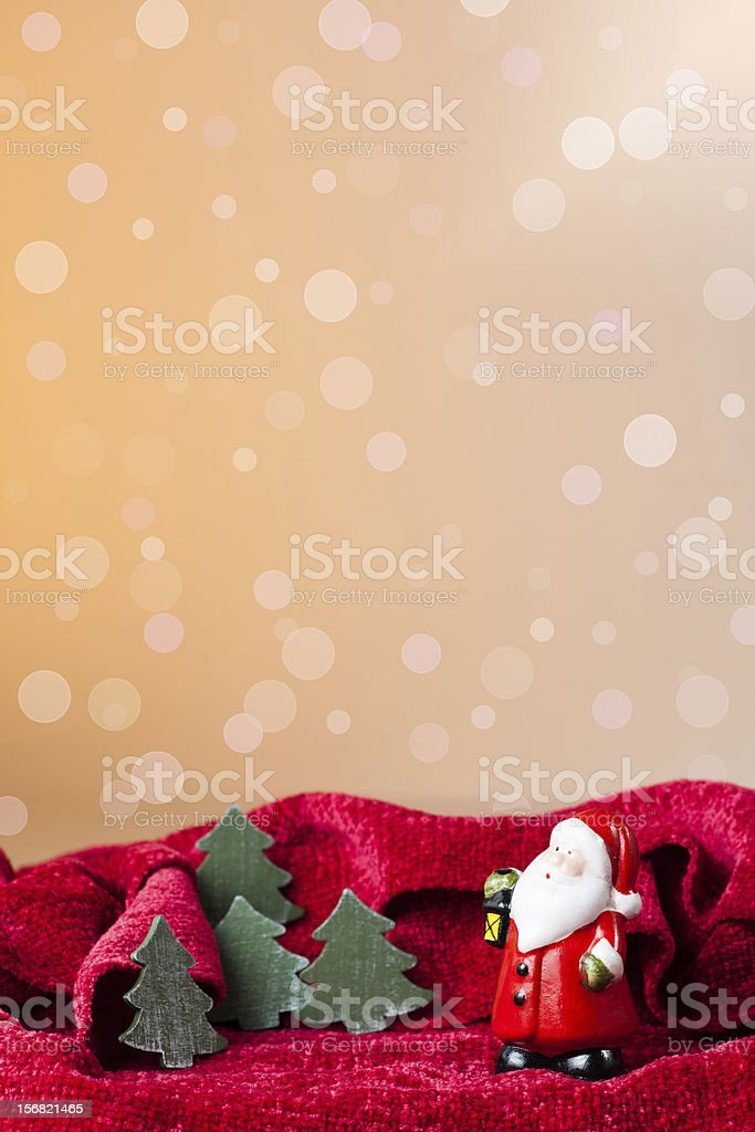 Christmas ornament: Santa Claus toy and little trees royalty-free stock photo