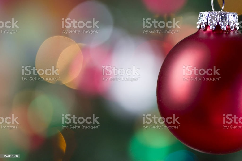 Christmas Ornament with Lighted Tree in Background, Copy Space royalty-free stock photo