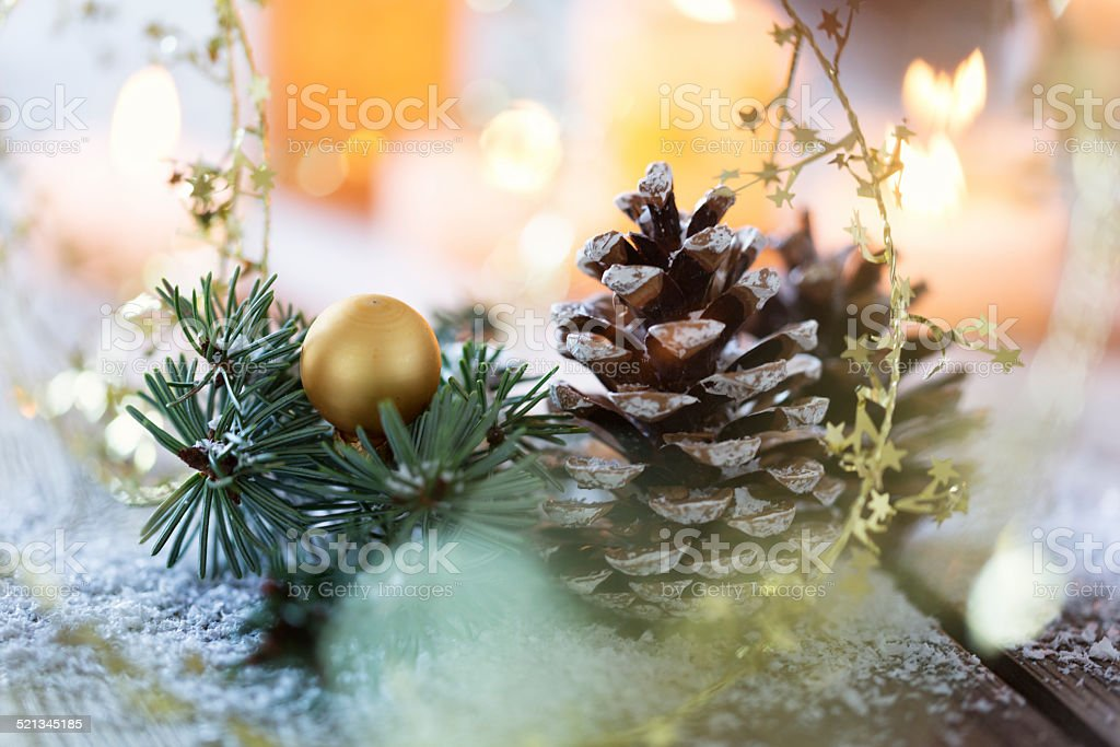 christmas ornaments and candle light on rustic wood stock photo